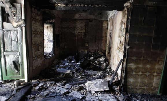 Damage is seen at the burnt out Saida Manoubia shrine in the governorate of Manouba, west of the capital, in Tunis